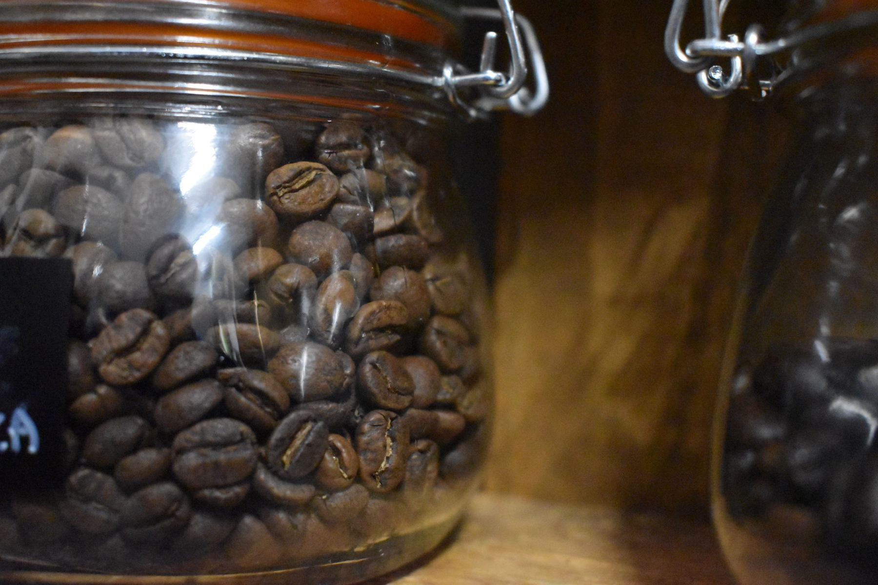 Close-up on a jar of coffee beans.